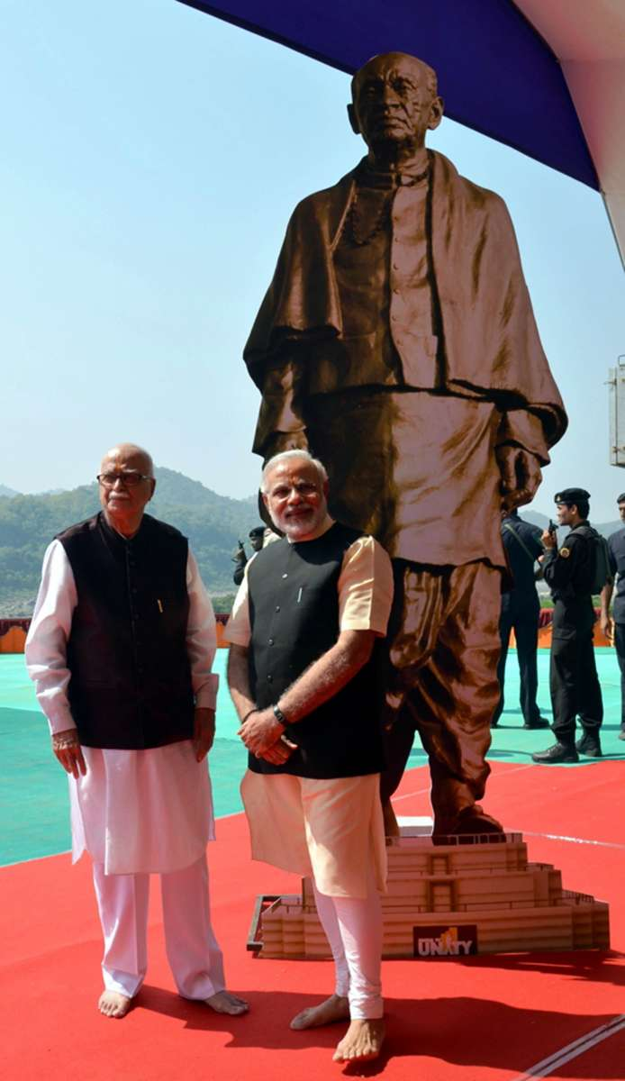 Senior BJP (Bharatiya Janata Party) leader L K Advani with BJP Prime Ministerial candidate and Gujarat Chief Minister Narendra Modi during the foundation stone laying ceremony for Sardar Patel's statue of Unity at Kevadia colony near Sardar Sarovar Dam on Oct.31, 2013. (Photo: IANS)