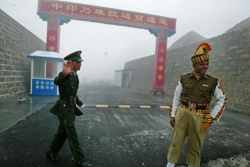 "In this photograph taken on July 10, 2008, a Chinese soldier (L) and an Indian soldier stand guard at the Chinese side of the ancient Nathu La border crossing between India and China. India's foreign minister announced plans on April 25, 2013, to visit China amid a border dispute, saying both countries had a mutual interest in not allowing it to ""destroy"" long-term progress in ties. According to officials in New Delhi, a platoon of Chinese troops set up a camp inside Indian territory on April 15, 2013. India has since called on the Chinese soldiers to withdraw, but several meetings between local army commanders and diplomats from both sides have failed to resolve the stand-off"
