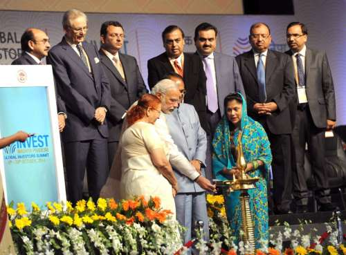 "The Prime Minister, Shri Narendra Modi lighting the lamp to inaugurate the ""Invest Madhya Pradesh - Global Investors Summit 2014"", at Indore, Madhya Pradesh on October 09, 2014. The Speaker, Lok Sabha, Smt. Sumitra Mahajan and other dignitaries are also seen."