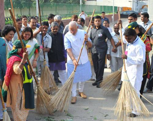 The Prime Minister, Shri Narendra Modi launching the cleanliness drive for Swacch Bharat Mission from Valmiki Basti, in New Delhi. FILE PHOTO