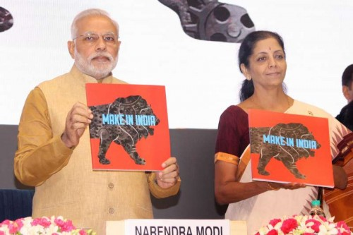 """Prime Minister Narendra Modi with Union Minister of State for Commerce & Industry (Independent Charge), Finance and Corporate Affairs, Nirmala Sitharaman launching """"Make in India"""" campaign in New Delhi on Sept. 25, 2014. FILE PHOTO"""