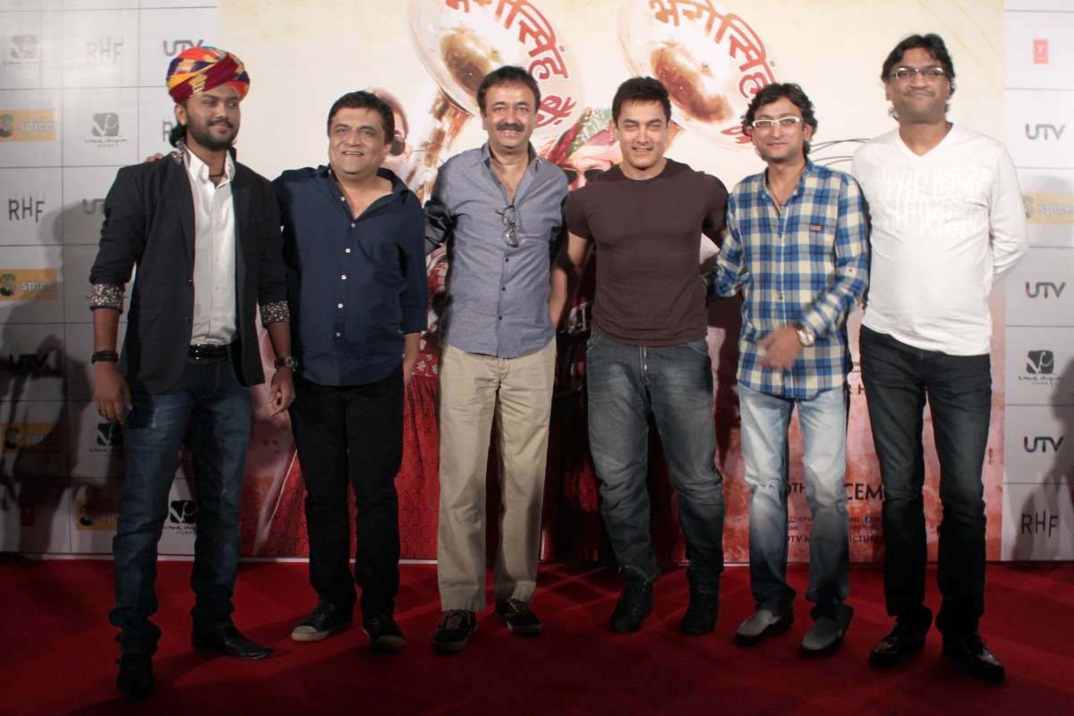 Actor Aamir Khan and filmmaker Rajkumar Hirani with star cast members of film `PK` during a press conference ,in Noida  (File)