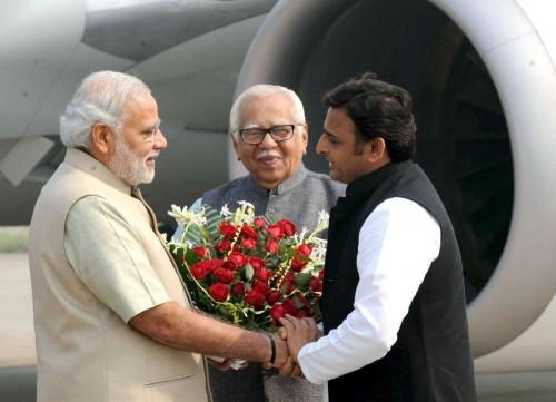 Prime Minister Narendra Modi being received by the Governor of Uttar Pradesh, Ram Naik and Uttar Pradesh Chief Minister Akhilesh Yadav, on his arrival at Varanasi airport on Nov 7, 2014.