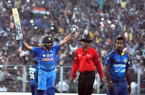 Indian batsman Rohit Sharma celebrates his double century during the 4th ODI between India and Sri Lanka at the Eden Gardens in Kolkata, on Nov 13, 2014.