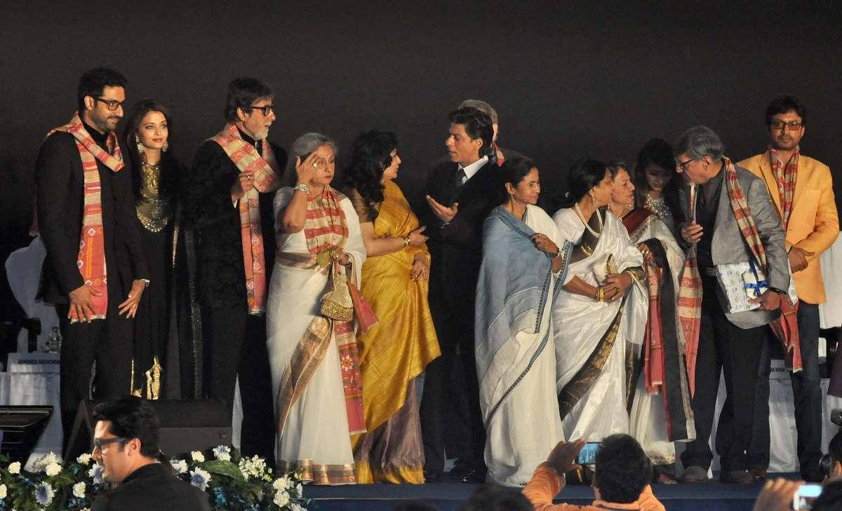 West Bengal Chief Minister Mamata Banerjee with actors Amitabh Bachchan, Jaya Bachchan, Shahrukh Khan, Abhishek Bachchan, Aishwarya Rai Bachchan, Irrfan Khan, Tanuja, Tanishaa, Amol Palekar and Moushumi Chatterjee during 20th Kolkata International Film Festival in Kolkata on Nov 10, 2014. (Photo: Kuntal Chakrabarty/IANS)