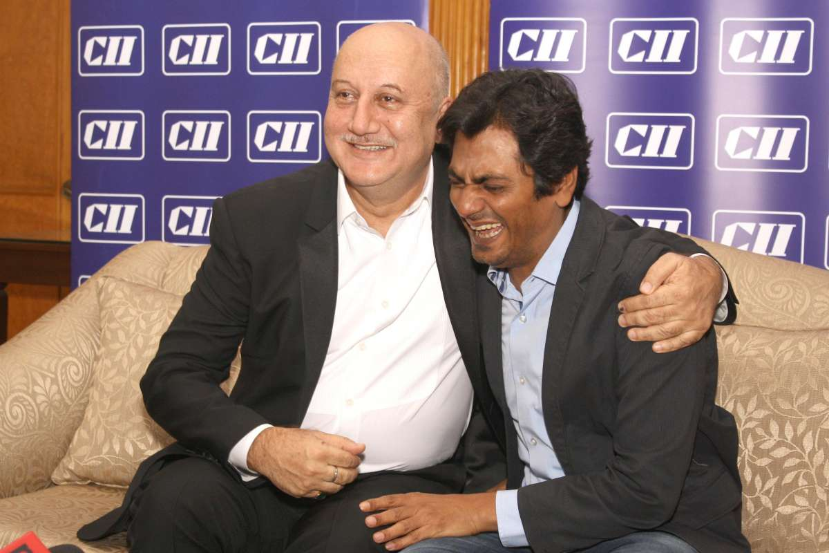 New Delhi: Actors Anupam Kher and Nawazuddin Siddique during the Service Conclave 2014, organized by CII, in New Delhi on Nov 12, 2014. (Photo: Amlan Paliwal/IANS)