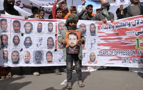 Relatives of Yemeni Guantanamo detainees hold pictures of the detainees during a rally demanding the release of them, outside the US embassy in Sanaa, Yemen Approximately 90 Yemeni nationals are currently detained in the U.S. prison in Guantanamo Bay in Cuba.