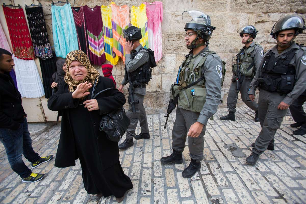 Palestinian women stand next to Israeli border police near a barrier leading to the Al-Aqsa Mosque near lions gate in Jerusalem's Old City, on Nov. 2, 2014. Israeli Prime Minister Benjamin Netanyahu called on Sunday to the Israeli right-wing Knesset members to show restraint in regard to the Jewish presence in the Al-Aqsa Mosque or the Temple Mount compound.