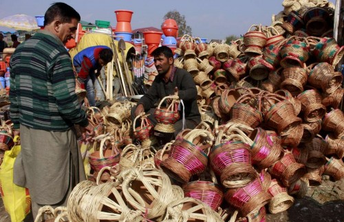 People buy `kangris` in a Srinagar market before winters. Kangri consists of decoratively crafted case made of wicker which is woven around an earthen pot and is used in Kashmir to keep one warm during winters.