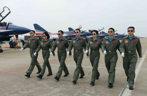 Members of China's Bayi Aerobatic Team, is seen with J-10 jet fighters on the runway at the 10th China International Aviation and Aerospace Exhibition in Zhuhai, south China's Guangdong Province, Nov. 11, 2014. This Tuesday marks the 65th anniversary of the establishment of the Air Force of the Chinese People's Liberation Army