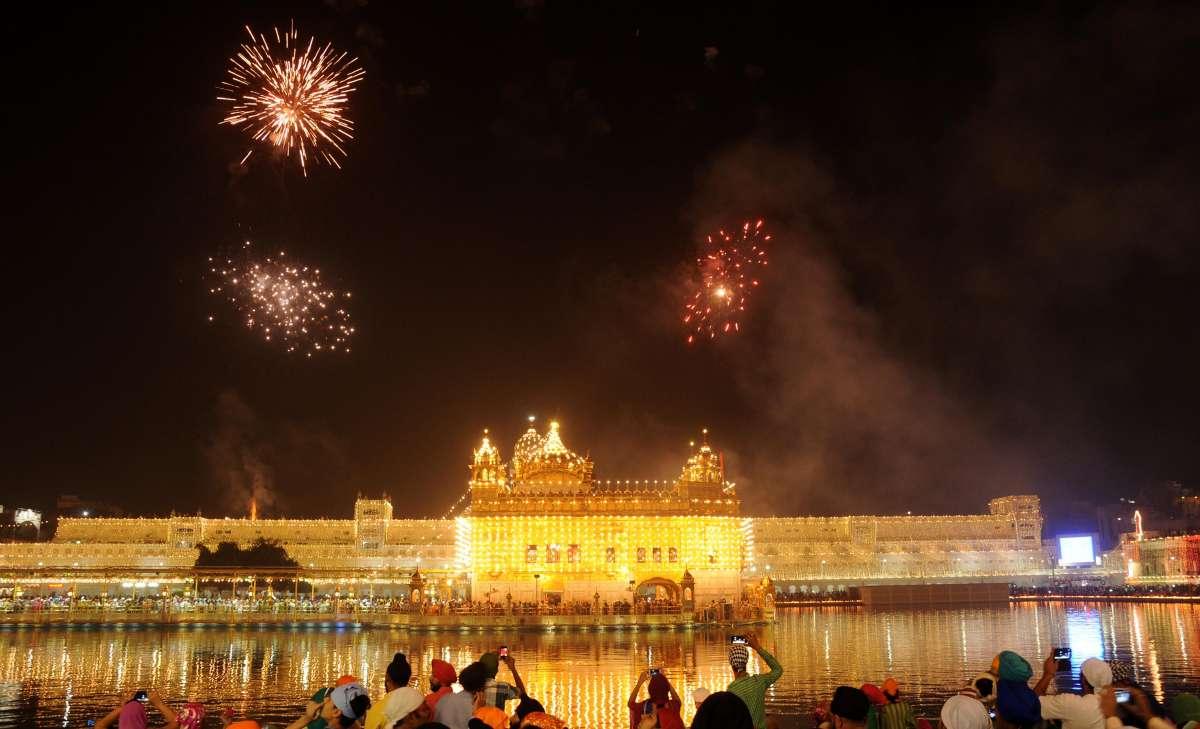 Amritsar: Fire works light up the sky above the Golden Temple on Guru Nanak Jayanti in Amritsar on Oct. 23, 2014. (Photo: IANS)