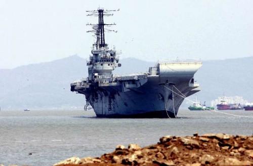 INS Vikrant near a ship-breaking yard at Darukhana in Mumbai