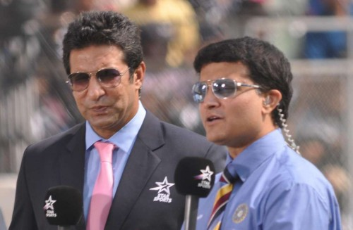 Former Indian skipper Sourav Ganguly and Wasim Akram during the 2nd Test Match between India and West Indies at Wankhede Stadium in Mumbai on Nov.14, 2013.FILE PHOTO