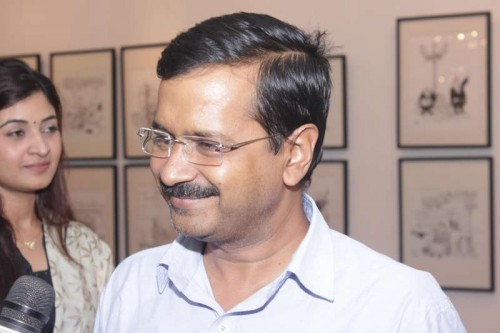 New Delhi: Aam Aadmi Party (AAP) Arvind Kejriwal at an art exhibition showcasing cartoonist Sudhir Tailang's creations at India Habitat Centre, in New Delhi on Nov.2, 2014. FILE PHOTO