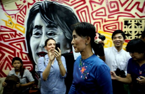 Aung San Suu Kyi  leader of Myanmar's National League for Democracy (NLD), leaves after a press conference at the party heardquarters in Yangon, Myanmar