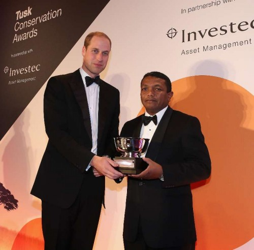 Prince William, Duke of Cambridge presents the Tusk Award for Conservation in Africa to Herizo Andrianandrasana at the Tusk Conservation Awards 2014 at Claridge's Hotel on November 25, 2014 in London, England. This is the second year of the Awards which celebrate the unsung heros of Conservation.