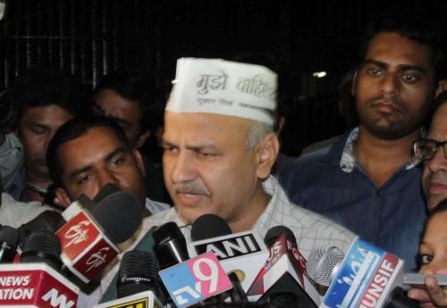 New Delhi: Aam Aadmi Party (AAP) leader Manish Sisodia addresses press after meeting Lieutenant Governor Najeeb Jung at Raj Niwas in New Delhi, on Nov.3, 2014.