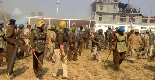 Police personnel surround the Satlok Ashram of self-styled godman and sect leader Rampal, near Barwala town in Haryana's Hisar district, 210 km from Chandigarh on Nov 18, 2014. Scores of people were injured as followers of the Rampal fought pitched battles with security forces outside the Ashram.The sect followers allegedly fired at the security forces and lobbed petrol bombs and acid pouches, police sources said, besides hurling stones and bricks. Rampal, is facing charges of murder, inciting mobs and contempt of court, remained holed up inside the complex. FILE PHOTO