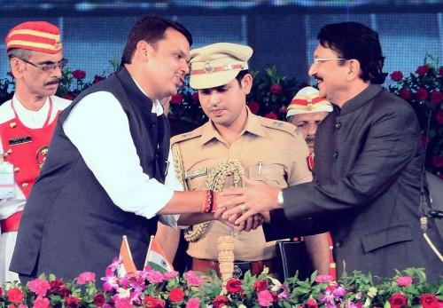 Mumbai: Maharashtra Chief Minister Devendra Fadnavis and Maharashtra Governor Chennamaneni Vidyasagar Rao during the swearing-in ceremony of the former at Wankhede Stadium in Mumbai, on Oct.31, 2014.