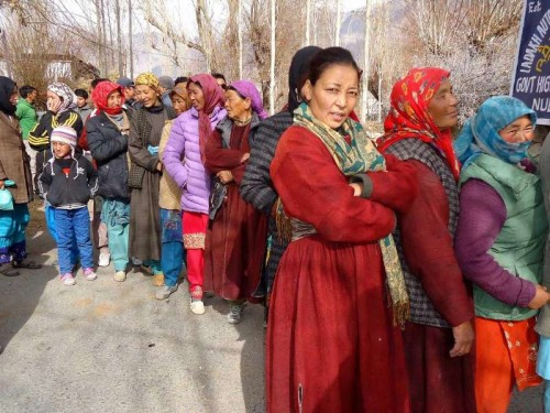 Women queue-up outside a polling booth  to cast their votes during the first phase of Jammu and Kashmir polls in Ladakh district of the state.