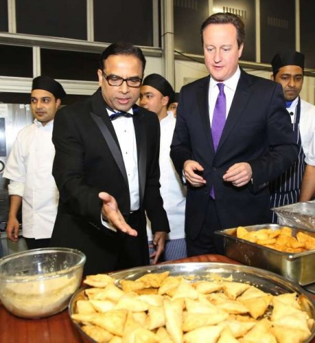 Prime Minister David Cameron getting a first hand experience in samosa making