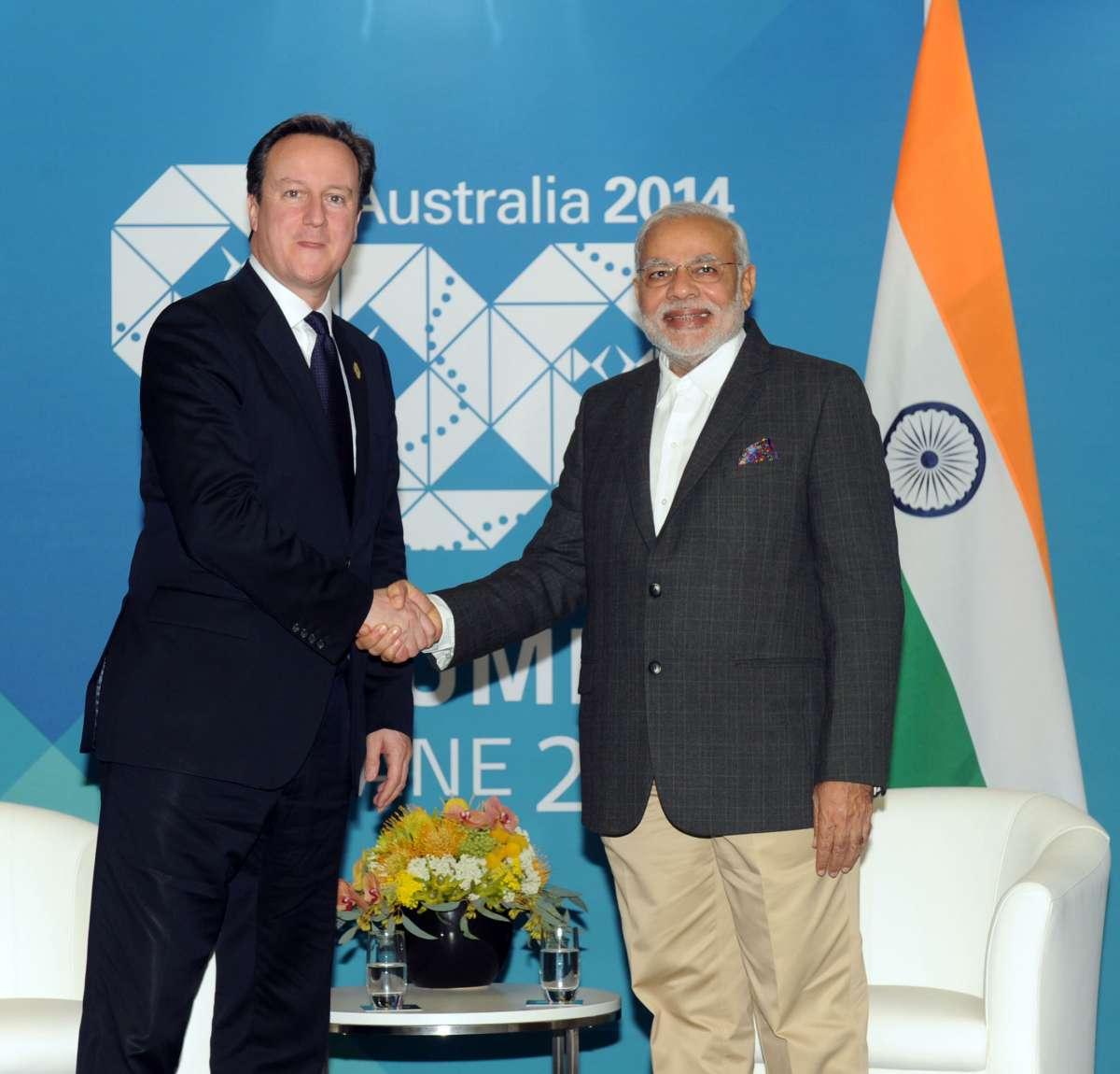 The Prime Minister, Shri Narendra Modi meeting the Prime Minister of United Kingdom, Mr. David Cameron, in Brisbane, Australia on November 14, 2014.