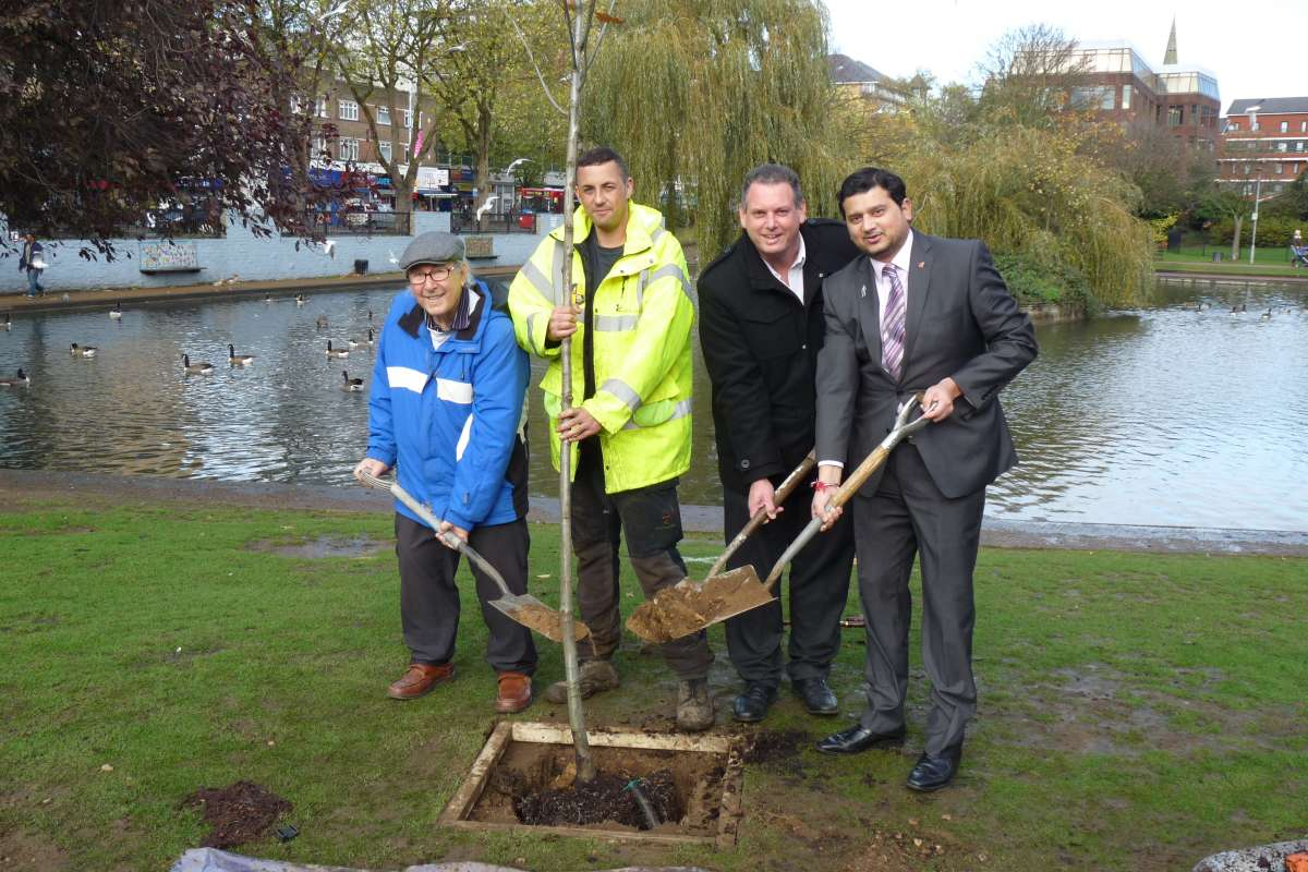 Councillor Sachin Gupta (right) joins members of the Feltham History Group Eddie Menday and Andi Barnes planting the first of 1,000 trees for Hounslow