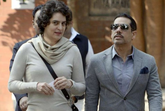 Daughter of former Prime Minister Rajiv Gandhi and UPA Chairperson Sonia Gandhi, Priyanka Gandhi and her husband Robert Vadra after casting their votes during Delhi Assembly Polls in New Delhi on Dec.4, 2013. (Photo: IANS)