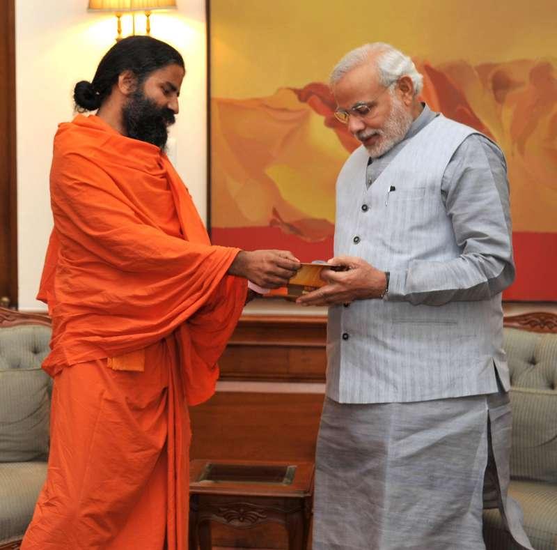 Yoga Guru Ramdev calls on Prime Minister Narendra Modi, in New Delhi.