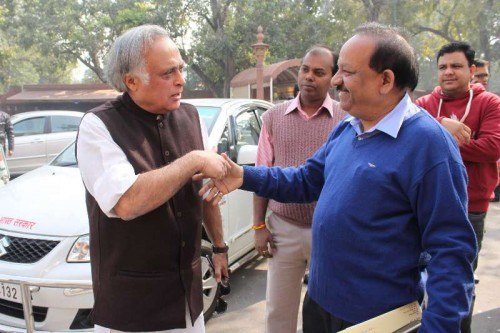Union Minister for Science and Technology and Earth Sciences Dr Harsh Vardhan greets Congress MP Jairam Ramesh at the Parliament House on the first day of Parliament's winter session in New Delhi, on Nov 24, 2014.