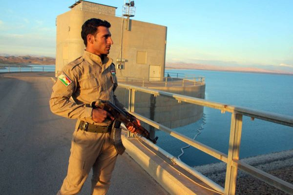 A Kurdish fighter is seen patrolling the Mosul Dam on the Tigris River, about 70 km north of the city of Mosul, northern Iraq on Nov.3, 2014. Iraqi and Kurdish security forces in August jointly took control of Mosul Dam, Iraq's largest dam, in the country's northern province of Nineveh after battles with so-called Islamic State militants who have been trying to regain the control of this important strategic location.