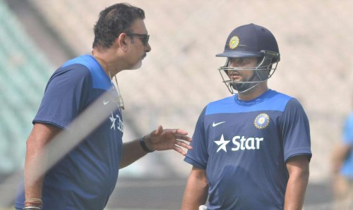 Kolkata: Team India director Ravi Shastri with Suresh Raina during a practice session ahead of the 4th ODI against Sri Lanka at the Eden Gardens in Kolkata, on Nov 12, 2014. (Photo: Kuntal Chakrabarty/IANS)