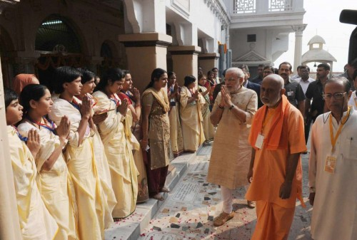 Varanasi: Prime Minister Narendra Modi visiting at the Maa Anandmayee Ashram, in Varanasi on Nov. 8, 2014.