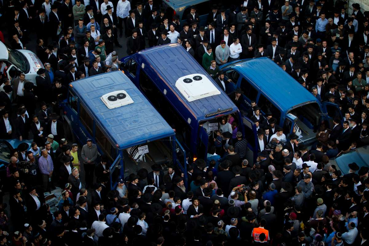 The bodies of Aryeh Kopinsky, Calman Levine and Avraham Shmuel Goldberg are seen in vehicles during a funeral near the scene of the attack at a synagogue in the Har Nof neighborhood of Jerusalem, on Nov. 18, 2014. Israeli Prime Minister Benjamin Netanyahu accused the Palestinian Authority of incitement as triggering the deadly attack on a Jerusalem synagogue Tuesday and urged the international community to denunciate terror and end Palestinian incitement.