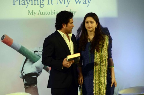 Cricket legend Sachin Tendulkar with his daughter Sara at the launch his autobiography `Playing It My Way` in Mumbai, on Nov 5, 2014.