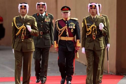Jordanian King Abdullah II reviews the honour guard