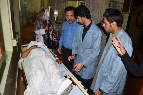 An injured female polio health worker receives medical treatment at a hospital in southwestern Pakistan's Quetta on Nov. 26, 2014. At least four polio workers were killed and three others were injured when gunmen open fire on a polio team in Quetta on Wednesday morning, local media reported.