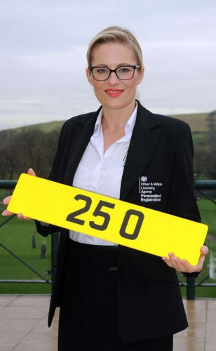 Jody Davies, DVLA Personalised Registrations' Head of Events, with registration 25 O which sold for British record £518,000