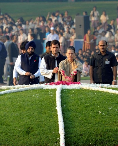 Congress chief Sonia Gandhi pays tribute to Pandit Jawaharlal Nehru - the first prime minister of India - on his 125th birth anniversary at Shantivan in New Delhi, on Nov 14, 2014. Also seen Congress vice-president Rahul Gandhi and Delhi Congress chief Arvinder Singh Lovely.