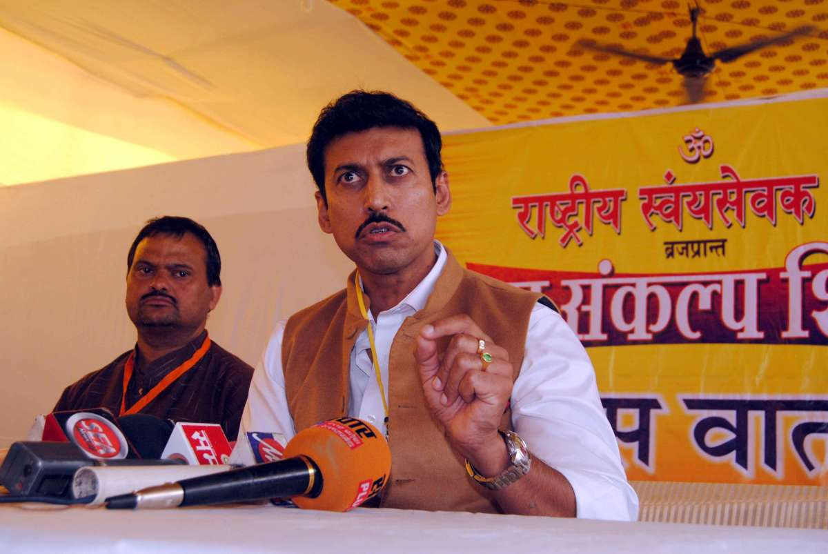 Former shooter and now BJP MP from Jaipur Rural, Rajyavardhan Singh Rathore addresses a press conference in Agra, on Nov.2, 2014.