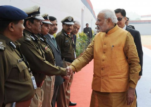 The Prime Minister, Shri Narendra Modi meeting the DGPs at the All India Conference of DGP/IGP, at Guwahati on November 30, 2014. The Minister of State for Home Affairs, Shri Kiren Rijiju is also seen.