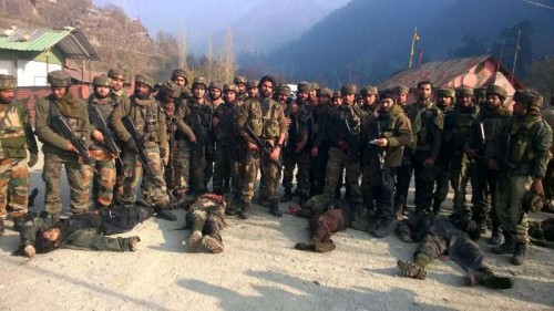 Soldiers present the bodies of the militants who mounted an audacious attack on Indian Army's Field Ordinance Camp at Mohra near the border town of Uri in Baramulla district of Jammu and Kashmir on Dec 5, 2014.
