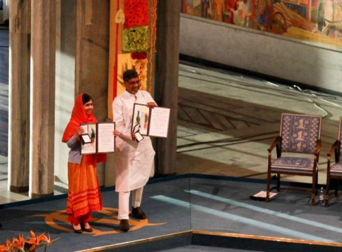 Kailash Satyarthi and Malala Yousafzai present their medals during the Nobel Peace Prize awarding ceremony in Oslo, Norway, Dec. 10, 2014. Kailash Satyarthi and Malala Yousafzai, two child welfare activists from Indian and Pakistan respectively, on Wednesday received the 2014 Nobel peace prize.