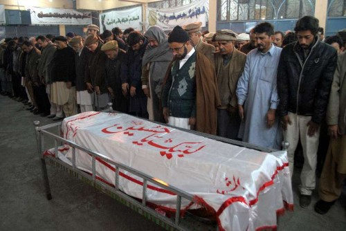Mourners attend the funeral of a student who was killed in an attack by militants on an army-run school in northwest Pakistan's Peshawar on Dec. 16, 2014.