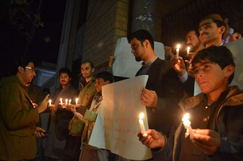 Members of Pakistani civil society light candles for the victims of an attack by militants on a school in southwest Pakistan's Quetta on Dec. 16, 2014. A total of 141 people including 132 students and nine staff members were killed and 133 others injured in Tuesday's terror attack at an army-run public school in Pakistan's northwest city of Peshawar, said a spokesman of the Pakistani army.