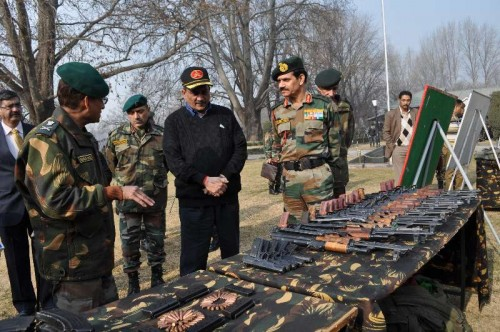 Jammu and Kashmir: Union Defence Minister Manohar Parrikar inspects the weapons and ammunition seized by the army during its various operations against the militants at the Chinar Corps camp in Jammu and Kashmir on Dec 11, 2014.