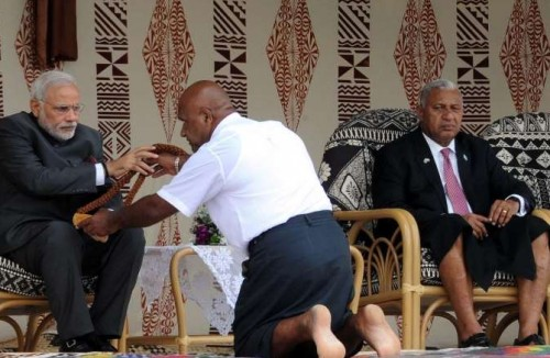 Suva: Prime Minister Narendra Modi being given traditional welcome, in Suva, Fiji on Nov 19, 2014. Also seen the Prime Minister of Fiji, Frank Bainimarama is also seen.