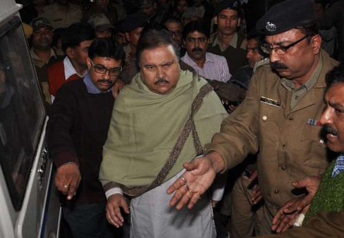 Trinamool Congress leader and West Bengal Transport Minister Madan Mitra, who was arrested by the CBI in connection with the multi-crore-rupee Sardha chit fund scam earlier today, being taken away by the officials in Kolkata, on Dec 12, 2014.