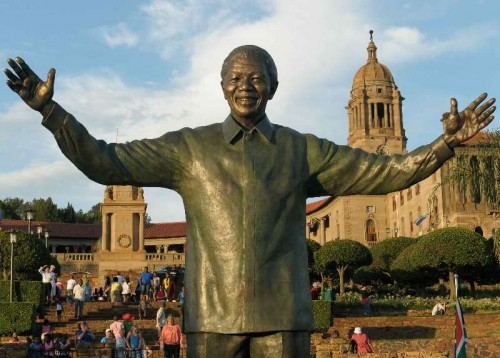 People visit the statue of former South African President Nelson Mandela at the Union Buildings in Pretoria.
