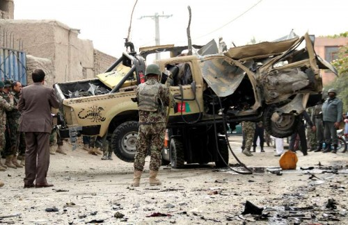 Afghan security forces transfer a destroyed military vehicle following a blast in Nangarhar province in east Afghanistan on Dec. 21, 2014. Earlier on Sunday, one soldier and a civilian were killed and five people wounded in two separate IED blasts in Jalalabad city, the provincial capital of Nangarhar province, police said.